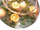 تزيين شمع و گل براي ميز نامزدي