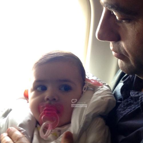 آرش مجیدی و همسرش ملیشا مهدی نژاد و فرزندشان